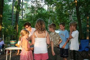 Kids help with communion during summer worship
