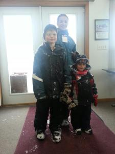 Kids coming inside to warm up after playing outside at Winter Fellowship.