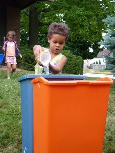 Kids fill wastebasket up with water