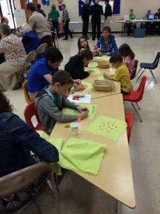 Kids making quilt squares