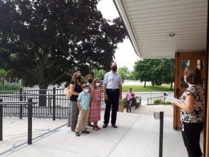 family at church doors