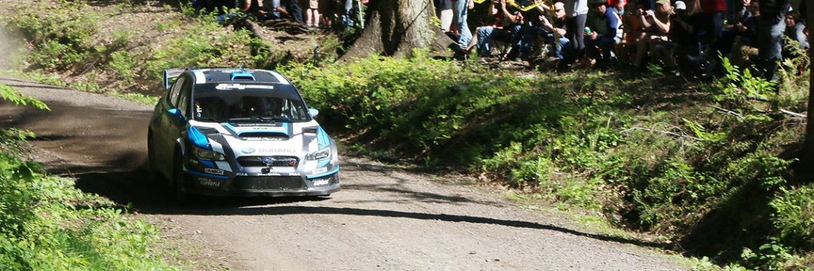 The Subaru Rally Team USA, David Higgins and co-driver Craig Drew, overjoy the crowd as they slide through the spectator area on the Lebo stage at STPR 2015. (Lori Lass)
