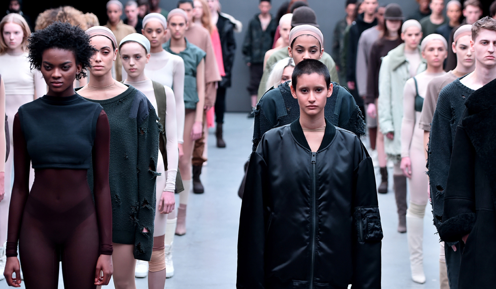 Instead of a traditional runway, models for the Kanye West x adidas Originals collection came out in full force and stood in rows like an army on a parade ground (Image via New York Post)