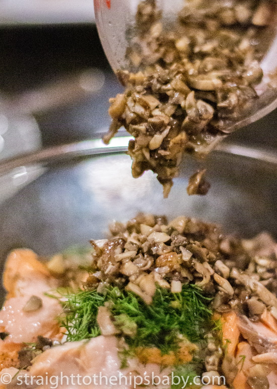 adding the mushrooms and dill to the salmon and rice mixture