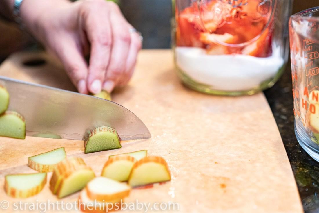 cutting slivers of rhubarb