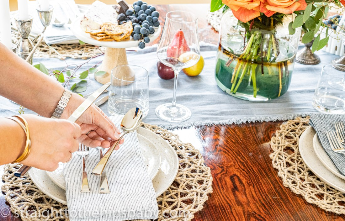 setting the table with china, linens, and silverware