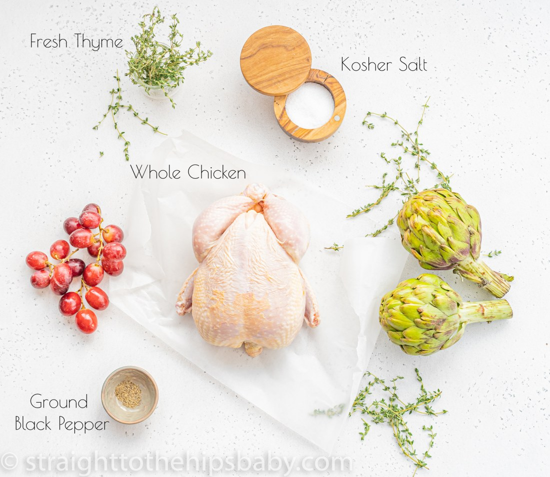 ingredient flat lay including a whole chicken, salt cellar, black pepper and fresh thyme