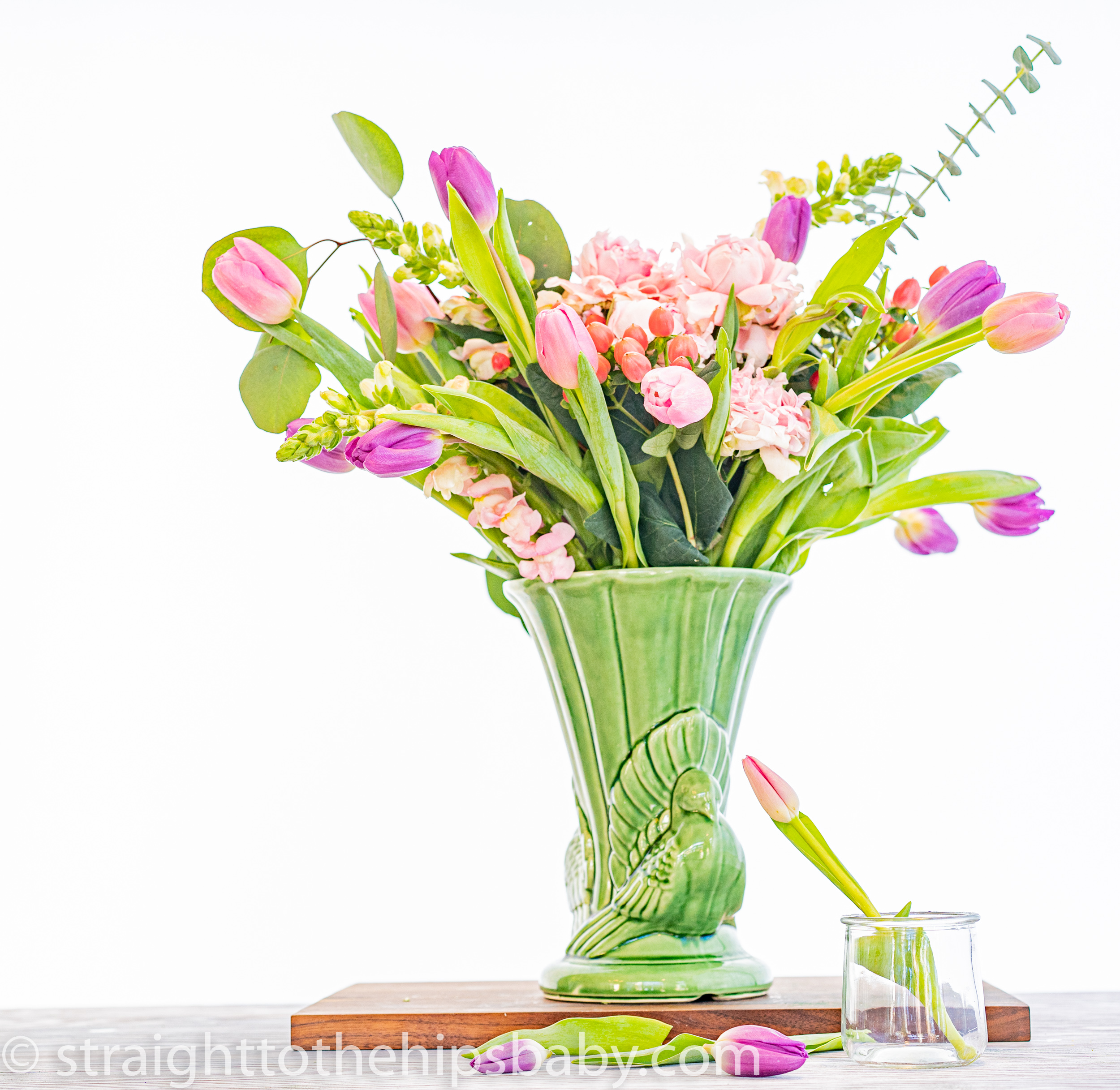 a bouquet of Easter flowers on a white background