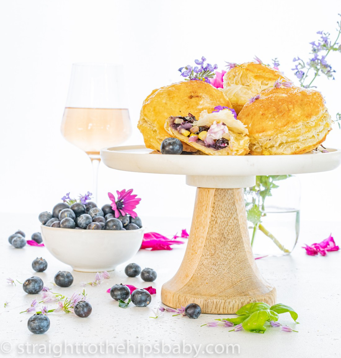 a standful of blueberry & Corn pastry bites with goat cheese