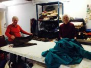 Marilyn Luce and Susan Singh work on fabric.