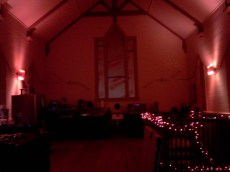 The kitchen bathed in red light. Newly designed stained glass windows are coming soon.