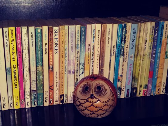 Owl figurine on a bookshelf