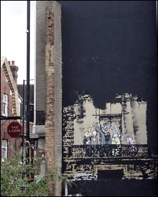 A mural by graffiti artist Banksy, which once featured on the cover of a single by rock band Blur, has been painted over by Hackney Council.  The spoof image of the Royal Family, painted on the side of a building in Stoke Newington, east London, was partially covered with black paint