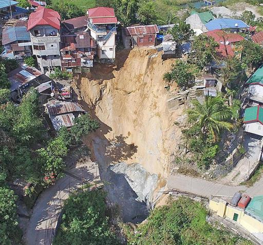 sinkhole benguet, sinkhole benguet october 2015 video, sinkhole benguet october 2015 picture, sinkhole benguet october 2015, sinkhole benguet philippines, A giant sinkhole swallowed 5 houses in Benguet, Philippines after the passage of Typhoon Lando. Photo video