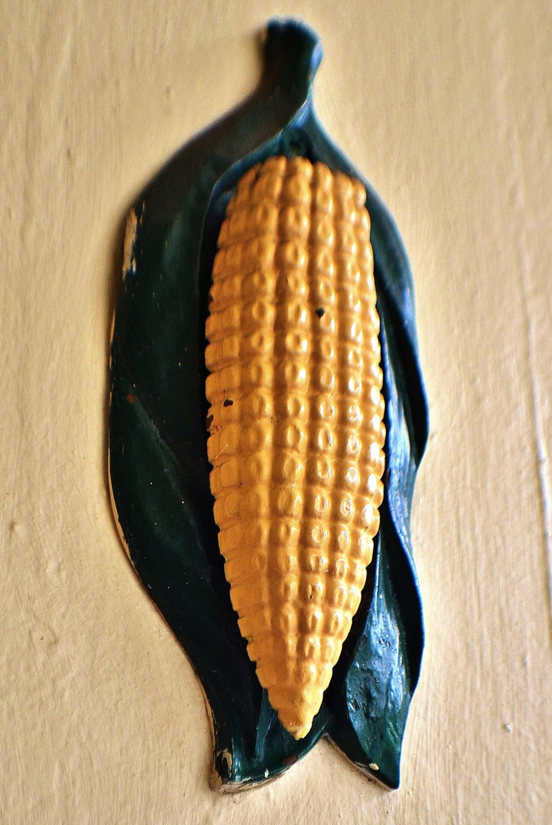 Cast iron corn cob door knocker at the Cornstalk Fence Hotel in the French Quarter of New Orleans
