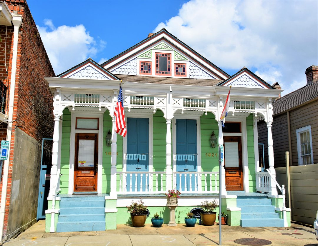 Double shotgun house with Eastlake Trim