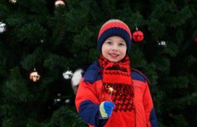 little boy dressed warm for holidays