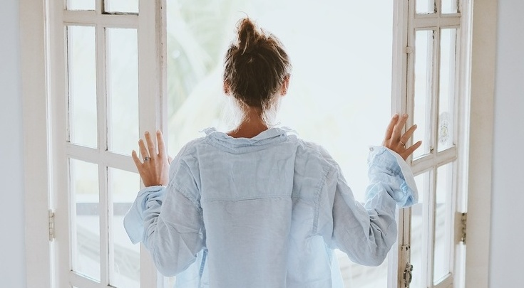 woman opening door to divorce season and future