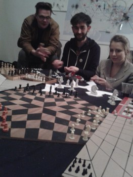 The Knight's Detour: Unworkshop in 3-Sided Trigomanic Chess Development & the Travelling Salesman's Dilemma. Experimental unworkshop in the construction of n-sided chess boards and pieces (Situmetry), building upon discussions around triolectically extending Abu Zakariya Yahya ben Ibrahim al-Hakim's Knight's Tour and Gherasim Luca's Cubomania - through which the chessboard is derived - into the two other forms of regular tessellation on a Euclidean plane (Hexamania and Trigomania) and beyond, towards further dimensions, into the streets and to the stars
