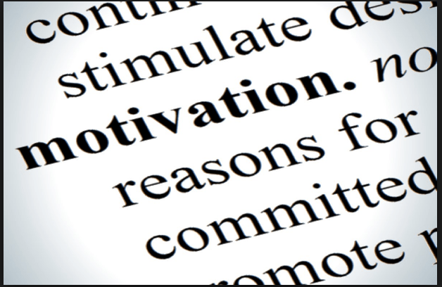 "Dictionary page open to the word ""motivated"""