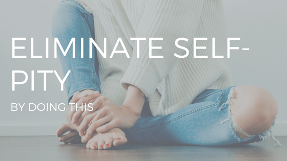 """ELIMINATE SELF PITY"" IN WHITE TEXT OVER A PHOTO OF A WOMAN WEARING A SWEATER AND JEANS, LOOKING SAD"