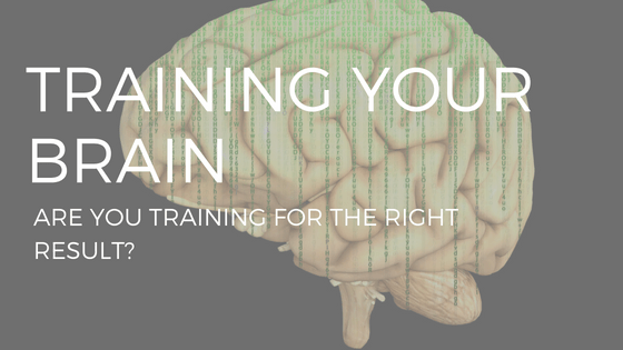 "text ""training your brain"" over an illustration of a yellow brain on a black background"