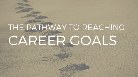 FOOTSTEPS IN SAND WITH WHITE TEXT READING: THE PATHWAYS TO REACH CAREER GOALS
