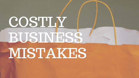 """Orange shopping bag with white text reading """"costly business mistakes"""""""