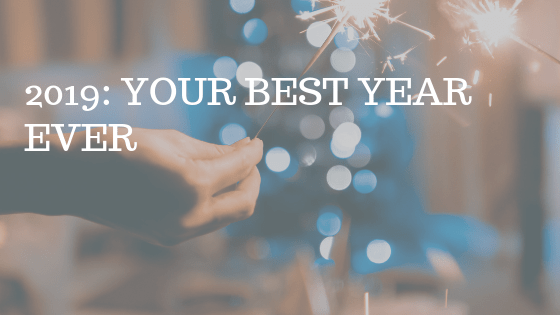 """Hand holding sparkler, with white text over reading """"2009: your best year ever"""""""