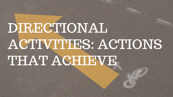 "photo is of an orange arrow painted on a street with white text over top reading ""directional activities: actions that achieve"""