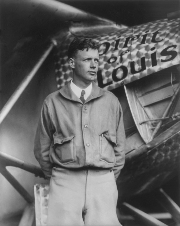 Charles Lindbergh standing next to the Spirit of St. Louis airplane he used for his solo Transatlantic flight