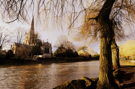 A view of Holy Trinity Church across the River Avon in Stratford-upon-Avon