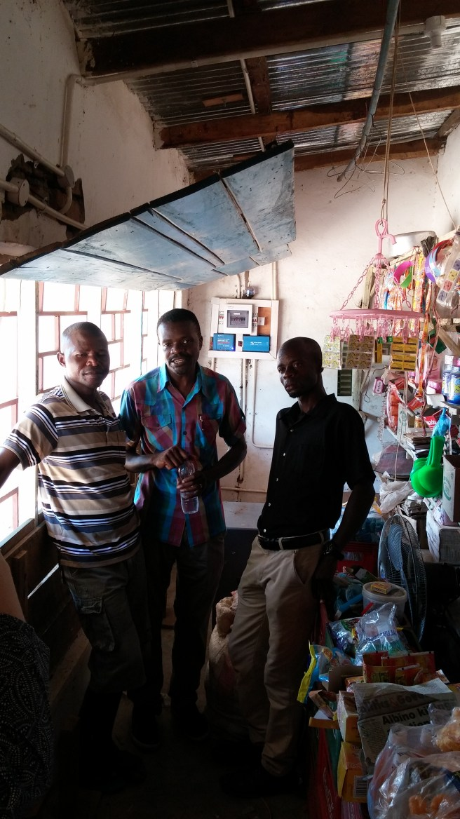 Franchiser Andrew Nkoloma (centre) with Franchisee (Francis Story) and a local business customer