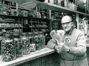 Vic Keary at Keary's Corner displaying lollies