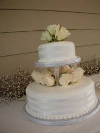 Wedding cake ribbons and roses