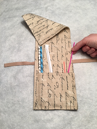 French script straw pouch-folded