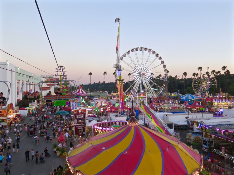 The largest COUNTY fair in the world generally attracts between 1.2 - 1.5 million visitors a year.
