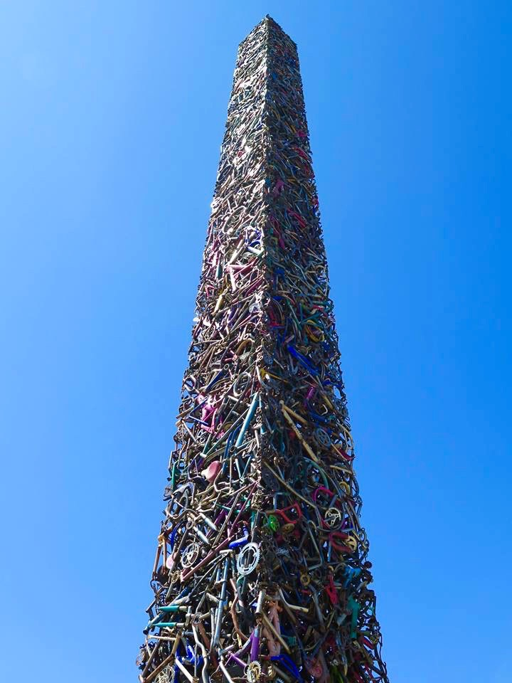 Northern California artists Mark Grieve and Ilana Spector built a 65-foot-tall, 10,000-pound obelisk out of around 340 bicycles — and one tricycle.
