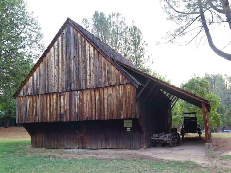 Across the street there is also a beautiful old barn that was built-in the mid eighteen hundreds and moved to the spot it is in now. It also has a stagecoach and some other farming tools there.