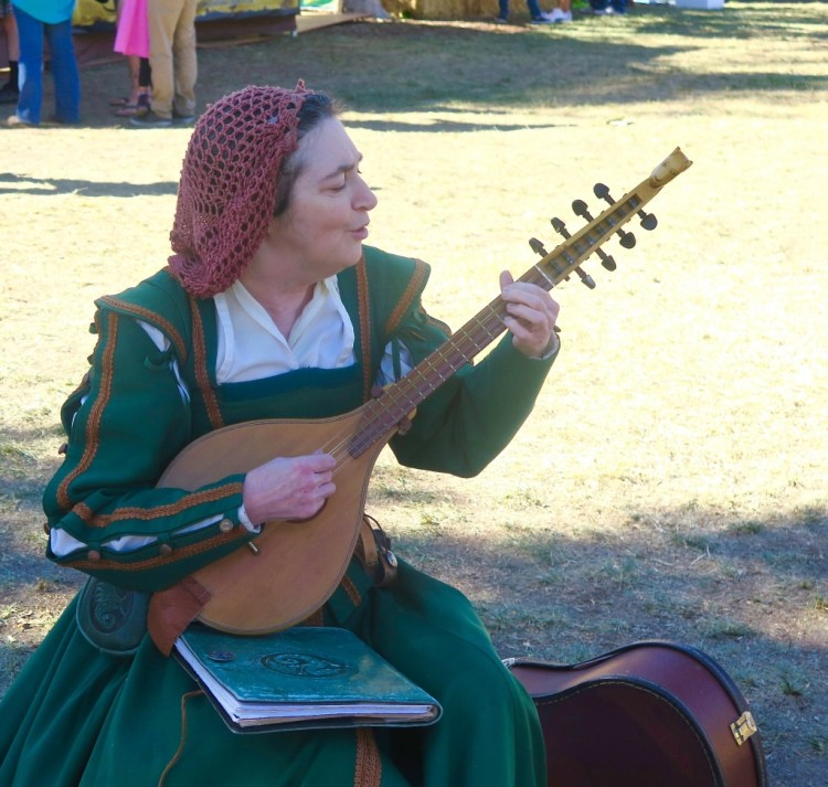 This lovely lady was playing a cittern that her husband had made her before he died. Sad and sweet, you could tell she was still trying to work through her grief. I think the music helps.
