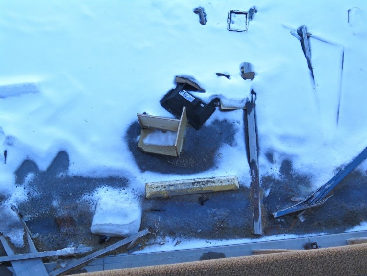 TV's and various other motel room items were strewn across the snow covered parking lot.