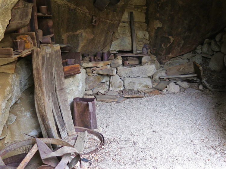 Dozens of artifacts remain in the structure, including original pots & pans, utensils, crates, and a collection of various types of tin cans and containers.