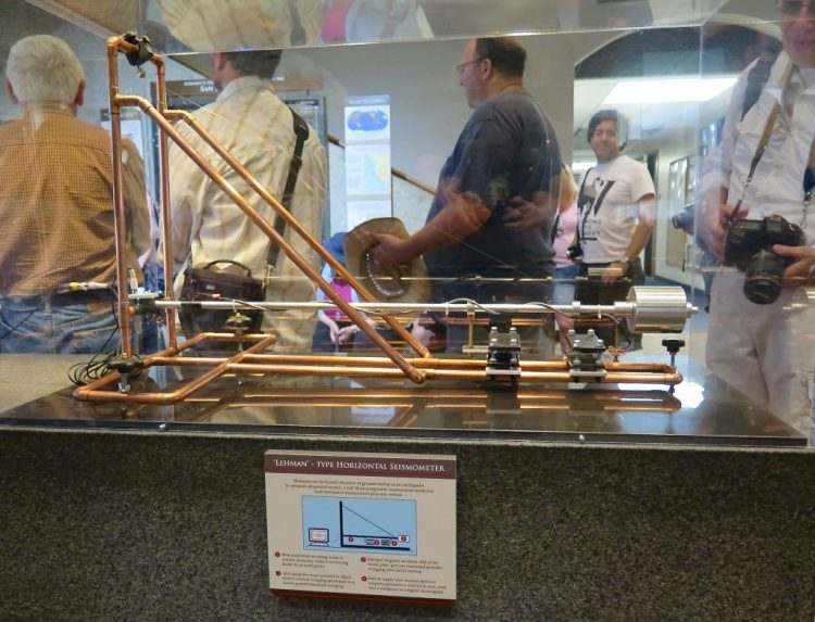 The exhibit area includes antique seismometers...