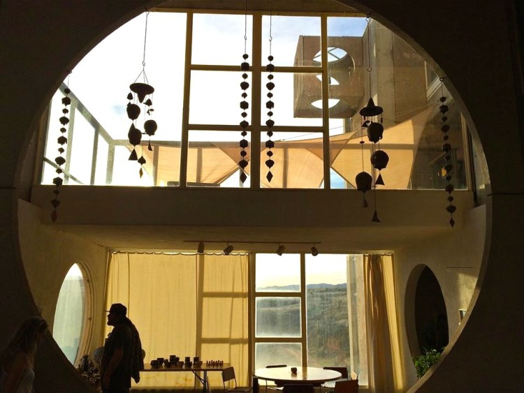 Ceramic and bronze wind bells hang in the 'Crafts III' building which houses the dining room, gift shop and Sky Suite, which is available for rent.