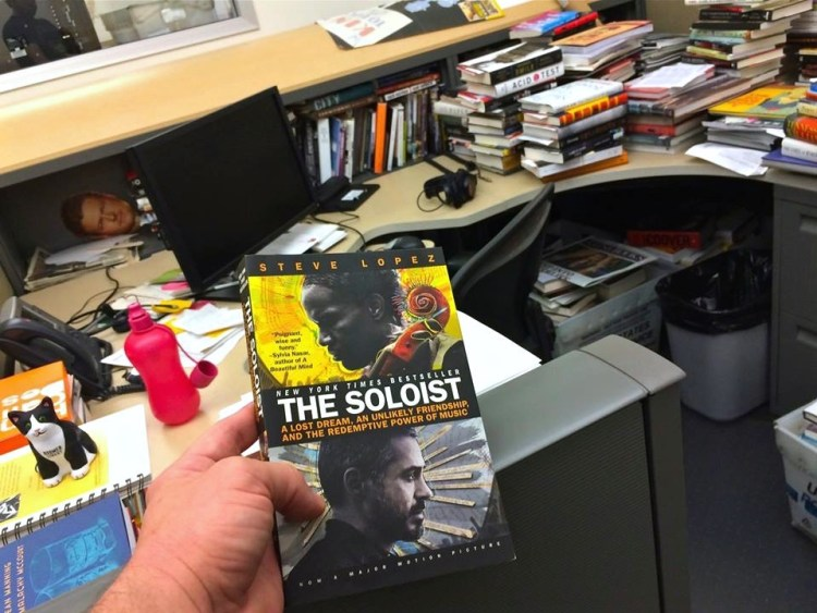 "We were gifted with Steve Lopez's book, ""The Soloist"". Those other books piled up in the background are there for the next Los Angeles Times Festival of Books coming up in April 2015"