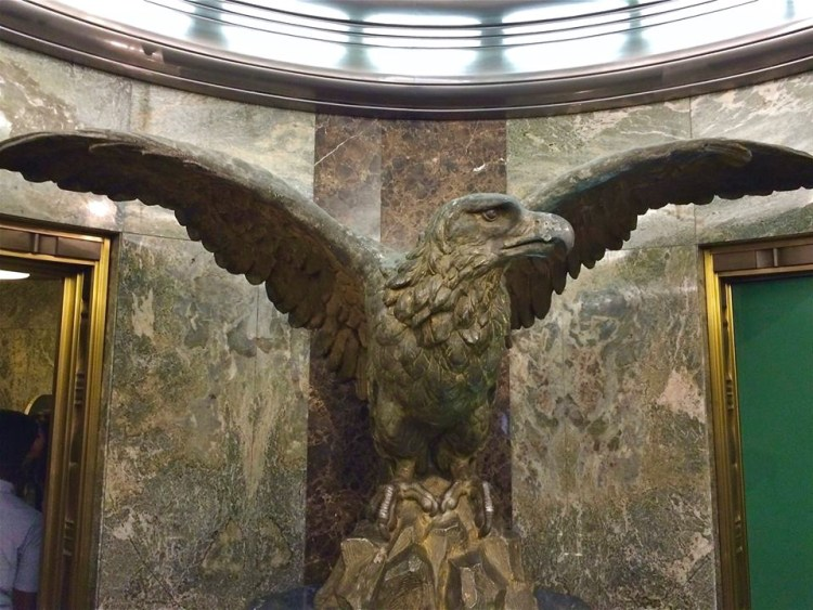 "Otis fastened this bronze eagle on top of a high frieze of the new Times headquarters building designed by Gordon Kaufmann, proclaiming anew the credo written by his wife, Eliza: ""Stand Fast, Stand Firm, Stand Sure, Stand True."""