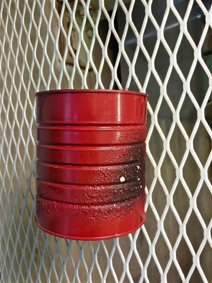 Part of the security measures to enter the underground silo included burning the authorization codes that were written down on a piece of paper and discarding the ashes into this red can.