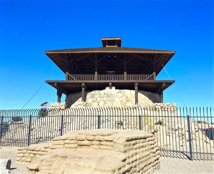 The main guard tower overlooks the entire prison. Beneath the wooden tower is the rock-walled reservoir, filled by the Colorado River.