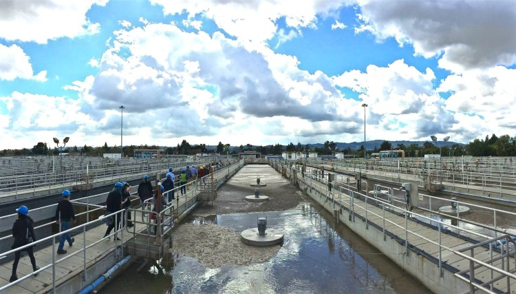 Oxygen is added in the nitrification process to speed up the bacteria's rate of decomposition. The nitrification-denitrification process reduces the amount of nitrogen in the plant's effluent. The wastewater, rich in activated sludge, then flows to the secondary clarifiers.