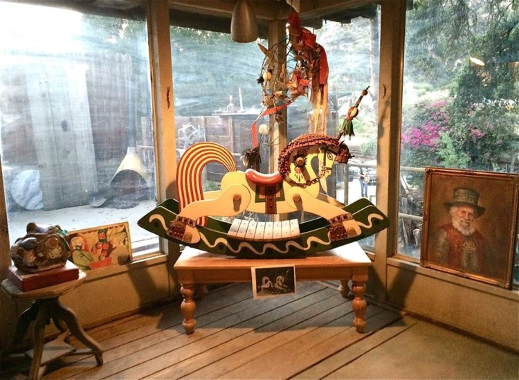 "Also in the gallery was this ornate rocking horse, carved and painted by Zorthian himself and used by a stripper one night back in July 15, 1952 to entertain jazz legend Charlie ""Bird"" Parker ."